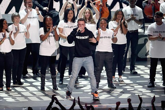 <p>Logic, center, performs during the VMAs. (Photo: Frederick M. Brown/Getty Images) </p>