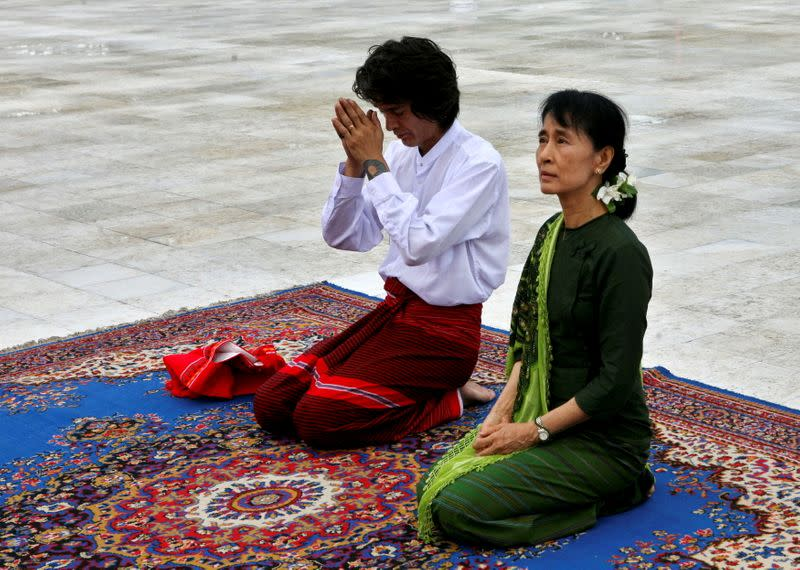 FILE PHOTO: Myanmar democracy leader Aung San Suu Kyi and her son Kim Aris pay their respects to the late General Aung San at the Martyr's Mausoleum