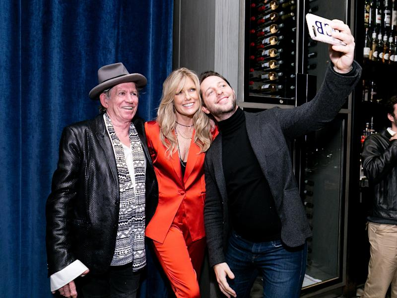 "NEW YORK, NY - NOVEMBER 12: (L-R) Keith Richards, Patti Hansen and Derek Blasberg pose at the launch of ""Patti Hansen: A Portrait"" hosted at the Gordon Bar at Sixty Soho on Nov. 12."" (Photo by Yvonne Tnt/BFA)"