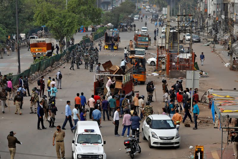 Delhi police file rioting charges against government critics