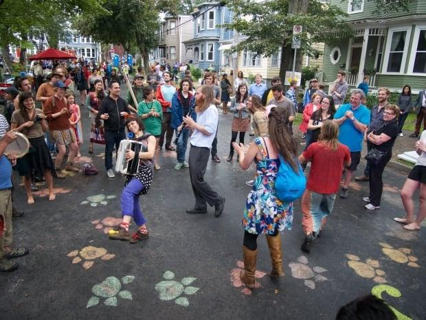 Open Streets events have taken place in Halifax and Dartmouth neighborhoods where part of a street is closed to traffic and pedestrians take over a block to eat, listen to music and shop. (Submitted - image credit)