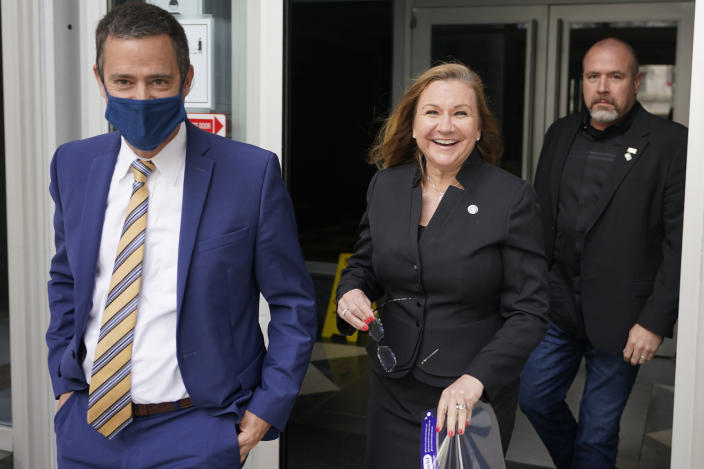 Virginia State Sen. Amanda Chase, R-Chesterfield, center, leaves court with her attorney Tim Anderson, left, during a break in a hearing to dismiss here lawsuit in Federal court in Richmond, Va., Thursday, April 1, 2021. (AP Photo/Steve Helber)
