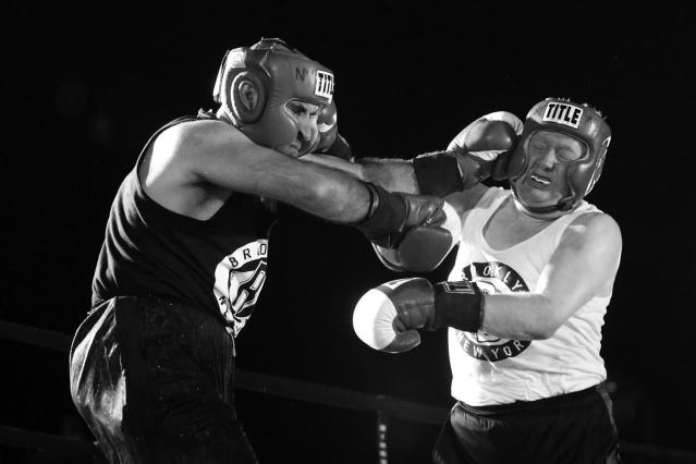 <p>Sgt. Russell Rodin and Sgt. Billy Gattis exchange punches in a battle of property clerks at the Brooklyn Smoker on Aug. 24, 2017. (Photo: Gordon Donovan/Yahoo News) </p>