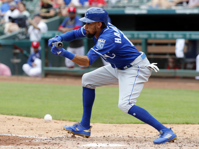 Kansas City Royals' Billy Hamilton connects for a bunt single on a pitch from Texas Rangers' Adrian Sampson in the fifth inning of a baseball game in Arlington, Texas, Sunday, June 2, 2019. (AP Photo/Tony Gutierrez)