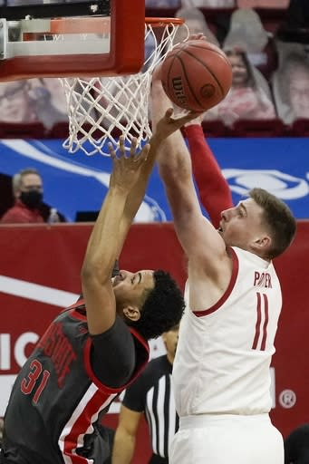 Wisconsin's Micah Potter stops a shot by Ohio State's Seth Towns during the second half of an NCAA college basketball game Saturday, Jan. 23, 2021, in Madison, Wis. (AP Photo/Morry Gash)