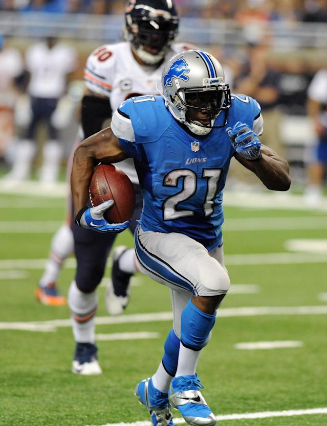 Detroit Lions running back Reggie Bush (21) runs for a 37-yard touchdown during the second quarter of an NFL football game against the Chicago Bears at Ford Field in Detroit, Sunday, Sept. 29, 2013. (AP Photo/Jose Juarez)