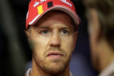 Formula One F1 - Singapore Grand Prix 2017 - Singapore - September 17, 2017 Ferrari's Sebastian Vettel speaks to the media after retiring from the race REUTERS/Jeremy Lee