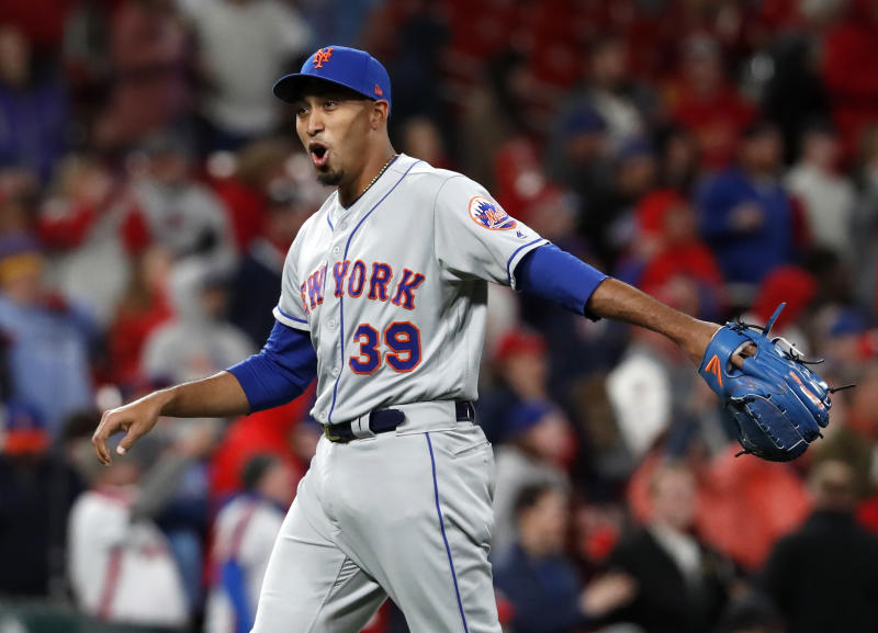 New York Mets relief pitcher Edwin Diaz celebrates after getting St. Louis Cardinals' Yadier Molina to fly out for the final out of a baseball game Friday, April 19, 2019, in St. Louis. The Mets won 5-4. (AP Photo/Jeff Roberson)