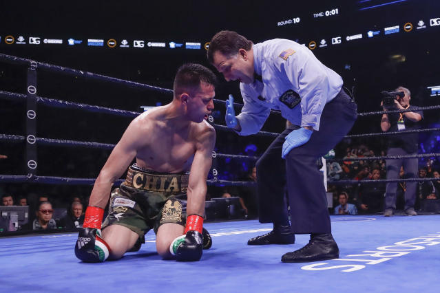 The referee counts for Francisco Santana after Santana was knocked down by Jarret Hurd during the 10th round of a super welterweight boxing match Saturday, Jan. 25, 2020, in New York. Hurd won the fight. (AP Photo/Frank Franklin II)