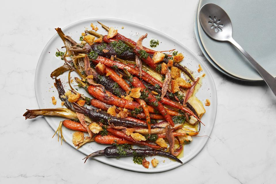 """These <a href=""""https://www.epicurious.com/expert-advice/how-to-pot-roast-carrots-spring-vegetables-article?mbid=synd_yahoo_rss"""" rel=""""nofollow noopener"""" target=""""_blank"""" data-ylk=""""slk:pot-roasted"""" class=""""link rapid-noclick-resp"""">pot-roasted</a> carrots were one of our most popular recipes in March—but they'd be perfect as a part of your <a href=""""https://www.epicurious.com/holidays-events/our-best-easter-dinner-recipes-and-menu-ideas-gallery?mbid=synd_yahoo_rss"""" rel=""""nofollow noopener"""" target=""""_blank"""" data-ylk=""""slk:Easter dinner"""" class=""""link rapid-noclick-resp"""">Easter dinner</a>, too. <a href=""""https://www.epicurious.com/recipes/food/views/young-carrots-with-spring-onions-sumac-and-anchovies?mbid=synd_yahoo_rss"""" rel=""""nofollow noopener"""" target=""""_blank"""" data-ylk=""""slk:See recipe."""" class=""""link rapid-noclick-resp"""">See recipe.</a>"""
