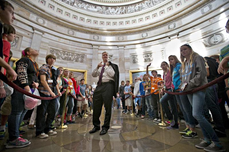 Rep. Steve Stivers, R-Ohio, talks to students from Heritage Middle School in Hilliard, Ohio, about the government shutdown and the looming debt ceiling crisis, as they visit the Capitol in Washington, Tuesday, Oct. 15, 2013. The partial government shutdown is in its third week with less than two days before the Treasury Department says it will be unable to borrow and will rely on a cash cushion to pay the country's bills. (AP Photo/J. Scott Applewhite)
