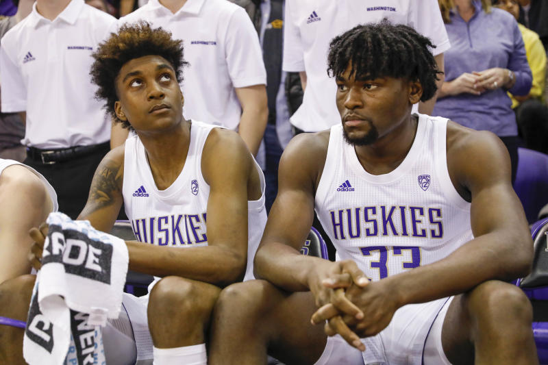 Washington Huskies forwards Jaden McDaniels (0) and Isaiah Stewart (33) sit on the bench before player introductions against Washington State. (USA Today)