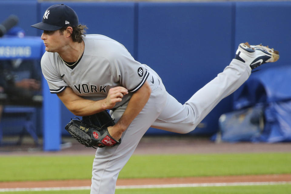 New York Yankees starting pitcher Gerrit Cole watches a throw to a Toronto Blue Jays batter during the first inning of a baseball game Wednesday, June 16, 2021, in Buffalo, N.Y. (AP Photo/Jeffrey T. Barnes)