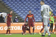 Roma's Gianluca Mancini, second from left, is celebrated by teammates after he scored his side's second goal during a Serie A soccer match between Roma and Inter Milan at Rome's Olympic stadium, Sunday, Jan. 10, 2021. (AP Photo/Gregorio Borgia)