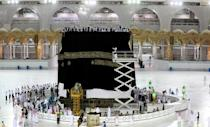Only a handful of pilgrims were in Mecca's Grand Mosque for the changing of the kiswa at this year's sharply scaled back hajj