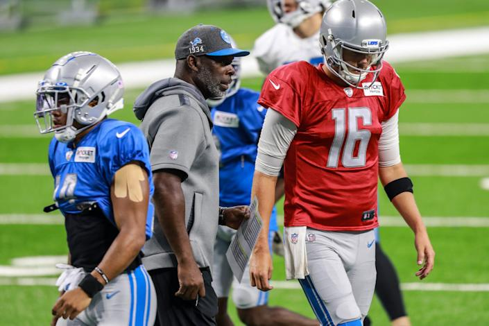 Lions offensive coordinator Anthony Lynn talks with QB Jared Goff during a team practice at Ford Field on Saturday, Aug. 7, 2021.