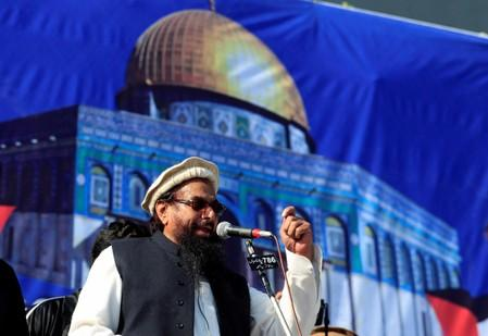 Hafiz Muhammad Saeed, chief of the Islamic charity organisation Jamaat-ud-Dawa, speaks to supporters during a gathering in Rawalpindi