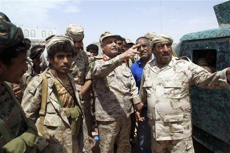 Yemen's Defence Minister Major General Muhammad Nasir Ahmad gestures as he visits Mayfaa, in the southeastern province of Shabwa