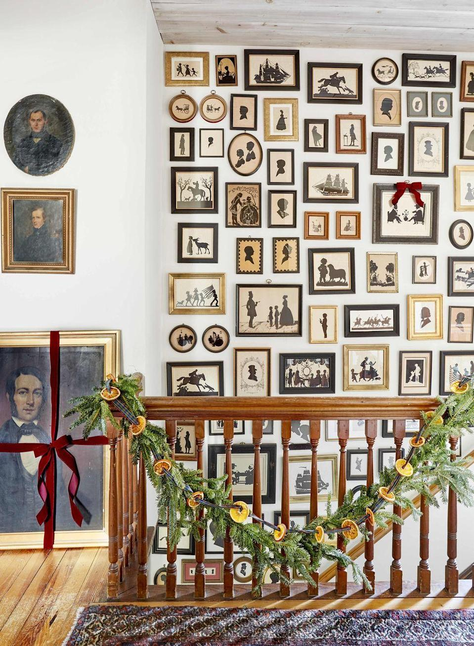 <p>Not only do air-dried orange slices smell great, but they're a more affordable way to customize a standard garland. String it along a bannister, mantel, or shelf, depending on what look you're going for. </p>
