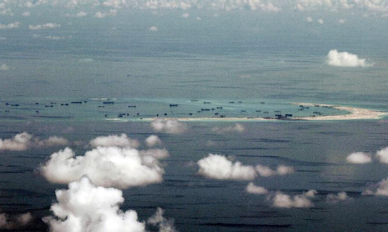 A photo taken from a military aircraft shows alleged on-going reclamation by China on Mischief Reef in the flashpoint Spratly Islands in the South China Sea (AFP Photo/Ritchie B. Tongo)