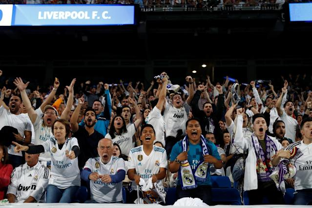 Soccer Football - Real Madrid fans watch the Champions League Final - Madrid, Spain - May 26, 2018 Real Madrid fans celebrate their first goal while inside the Santiago Bernabeu REUTERS/Javier Barbancho