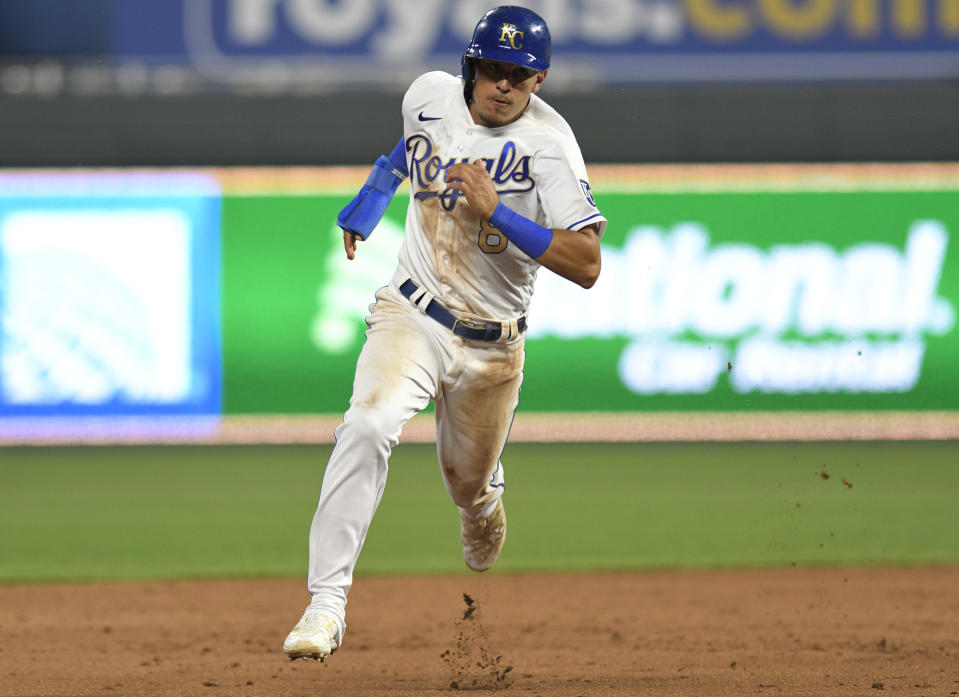 Kansas City Royals' Nicky Lopez sprints to third base on his way to scoring on a double by teammate Whit Merrifield during the sixth inning of a baseball game against the Boston Red Sox in Kansas City, Mo., Friday, June 18, 2021. (AP Photo/Reed Hoffmann)