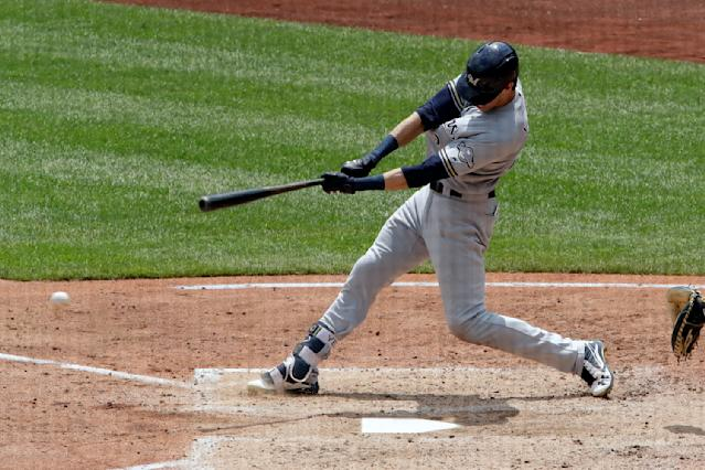 Milwaukee Brewers' Christian Yelich drives in a run with a single off Pittsburgh Pirates starting pitcher Ivan Nova in the fifth inning of a baseball game in Pittsburgh, Saturday, July 14, 2018. (AP Photo/Gene J. Puskar)