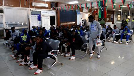 Guinean migrants wait at the airport before they are deported to Guinea, in Misrata, Libya, December 27, 2017. REUTERS/Ismail Zitouny
