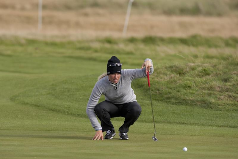 Norway's Suzann Pettersen lines up a putt on the 17th green during the first round of the Women's British Open golf championships at Royal Liverpool Golf Club, Hoylake, England, Thursday Sept. 13, 2012.  (AP Photo/Jon Super)