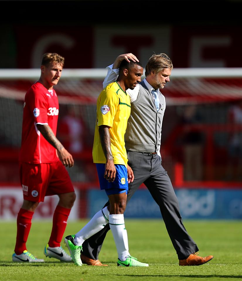 Coventry City's manager Steven Pressley consoles Callum Wilson at the end of the match during the Sky Bet League One match at Broadfield Stadium, Crawley.