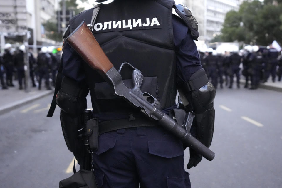 Serbian police guards the area as demonstrators take the streets to protest potential new COVID-19 restrictions announced by the government in Belgrade, Serbia, Saturday, Sept. 18, 2021. (AP Photo/Darko Vojinovic)