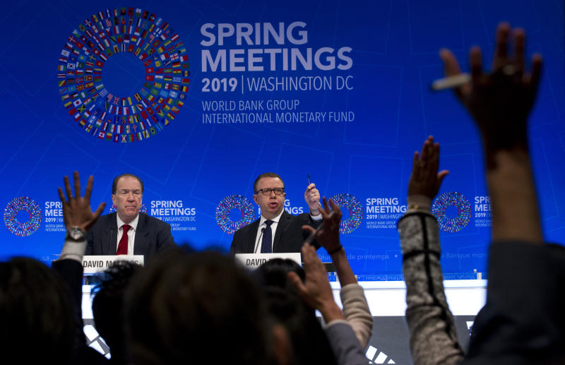 World Bank President David Malpass accompanied by World Bank press secretary David Theis speak at a news conference during the World Bank/IMF Spring Meetings in Washington, Thursday, April 11, 2019. (AP Photo/Jose Luis Magana)