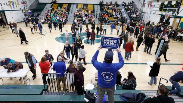 PHOTO: A supporter for Democratic presidential candidate Andrew Yang waits in the stands before a Democratic caucus at Hoover High School, Feb. 3, 2020, in Des Moines, Iowa. (Charlie Neibergall/AP)