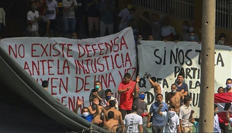 Inmates of Lima's Castro Castro prison protested following a deadly riot amid growing fears over the spread of the coronavirus (AFP Photo/Jesus OLARTE)