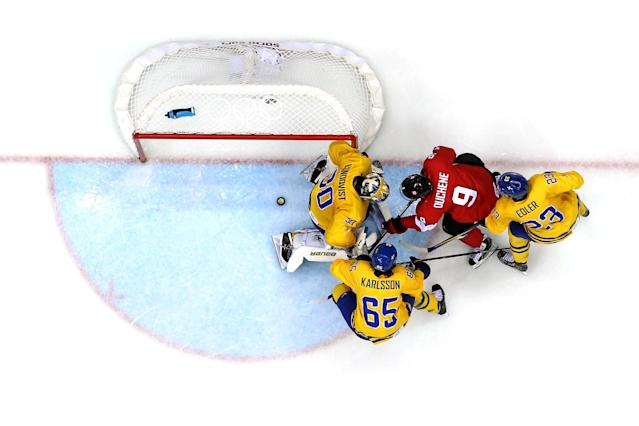 SOCHI, RUSSIA - FEBRUARY 23: Matt Duchene #9 of Canada attempts to score a goal against Henrik Lundqvist #30, Alexander Edler #23 and Erik Karlsson #65 of Sweden during the Men's Ice Hockey Gold Medal match on Day 16 of the 2014 Sochi Winter Olympics at Bolshoy Ice Dome on February 23, 2014 in Sochi, Russia. (Photo by Bruce Bennett/Getty Images)