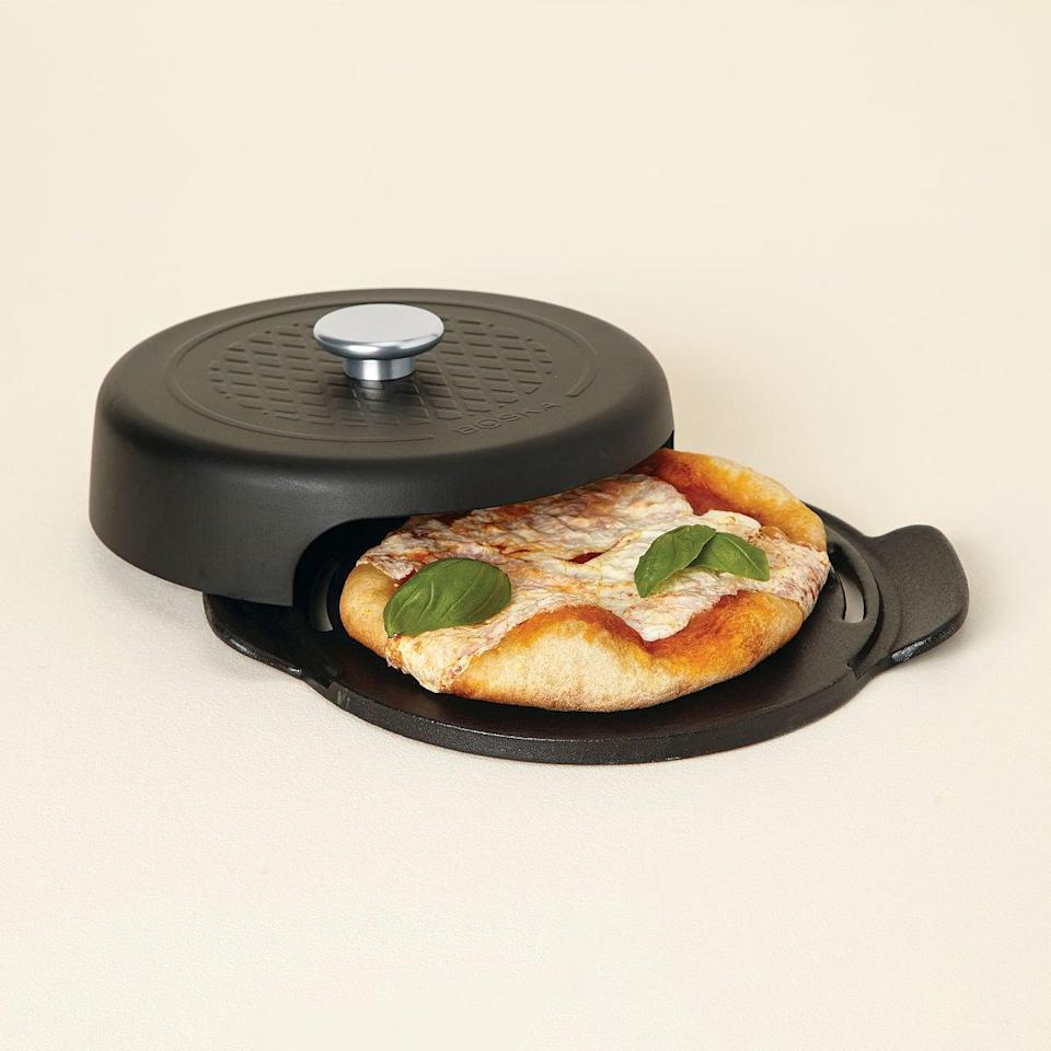 <p>The <span>Grilled Personal Pizza Maker</span> ($35) is perfect for making yummy homemade pizzas right on your barbecue or stove. The cast-iron device makes brick-oven-style pizza with ease in less than 10 minutes.</p>