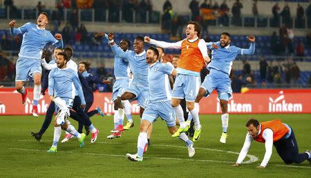 Football Soccer - AS Roma v Lazio - Italian Cup - Olympic Stadium, Rome, Italy - 4/04/17 Lazio's players celebrate at the end of the match. REUTERS/Tony Gentile
