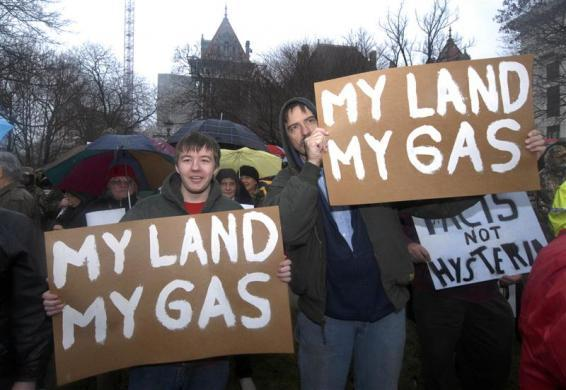 Alex Knapp (L) and his father Albert Knapp of Berkshire, hold placards as they protest in favor of the drilling process of hydraulic fracturing to extract natural gas at the Capitol in Albany, New York January 25, 2010.