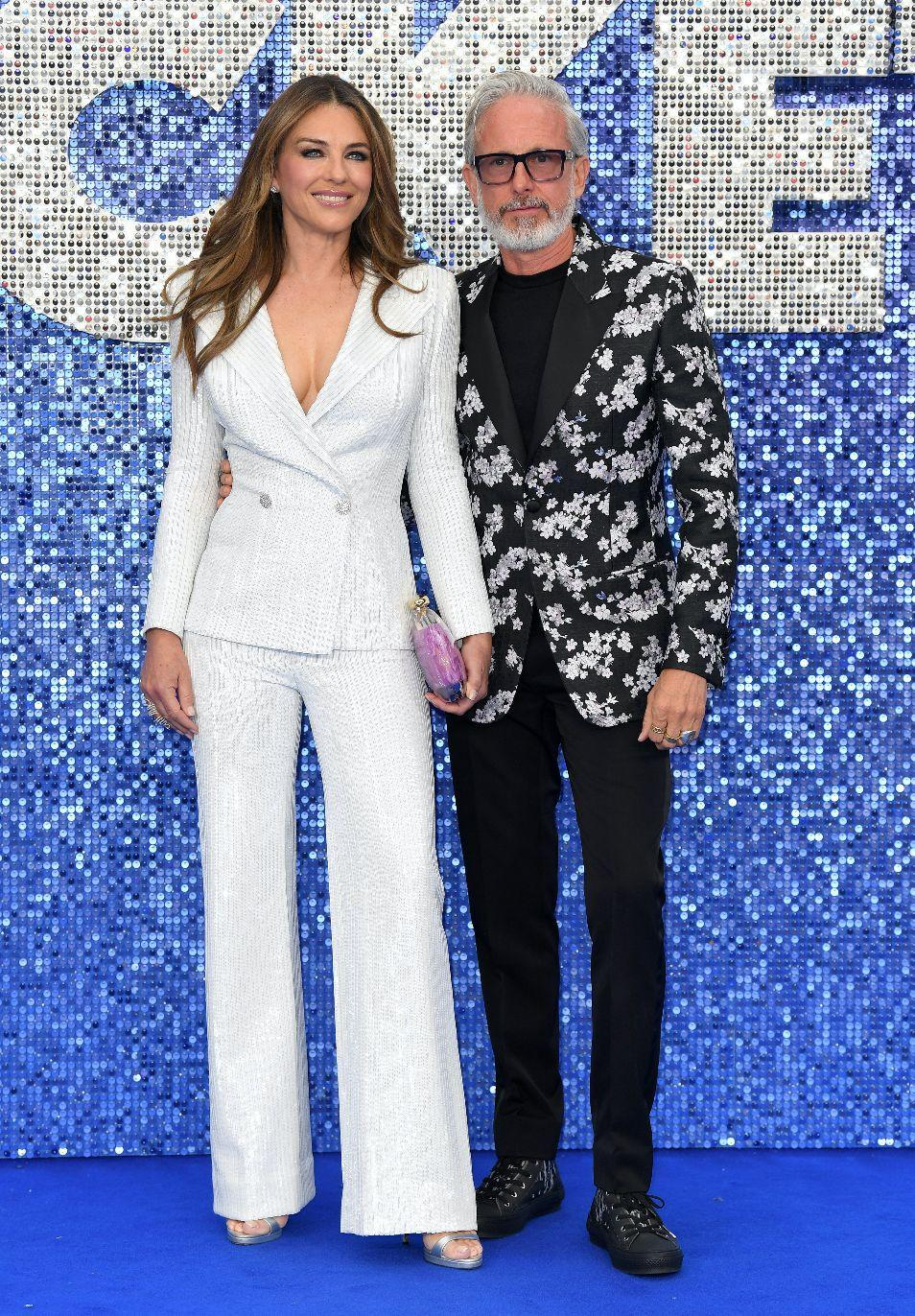 Elizabeth Hurley and Patrick Cox at the 'Rocketman' premiere. [Photo: Getty]