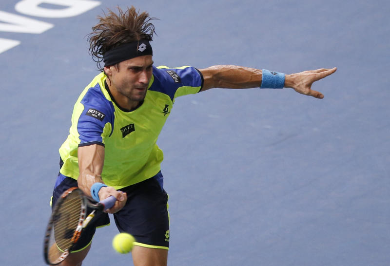 David Ferrer of Spain returns the ball to Novak Djokovic of Serbia during their final match, at the Paris Masters tennis at Bercy Arena in Paris, France, Sunday, Nov. 3, 2013. (AP Photo/Francois Mori)