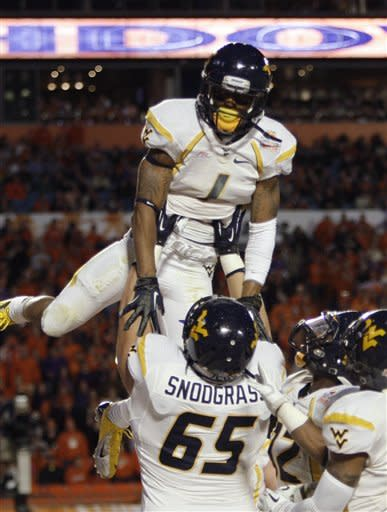 West Virginia's Chad Snodgrass (65) lifts wide receiver Tavon Austin (1) after Austin scored a touchdown during the first half of the Orange Bowl NCAA college football game against Clemson, Wednesday, Jan. 4, 2012, in Miami. (AP Photo/Lynne Sladky)