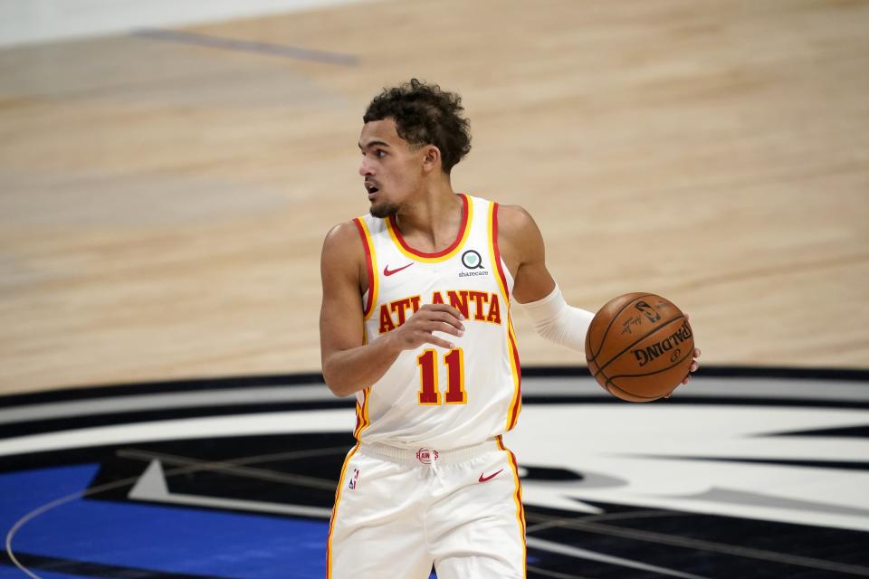 Atlanta Hawks' Trae Young (11) advances the ball up court in the first half of an NBA basketball game against the Dallas Mavericks in Dallas, Wednesday, Feb. 10, 2021. (AP Photo/Tony Gutierrez)
