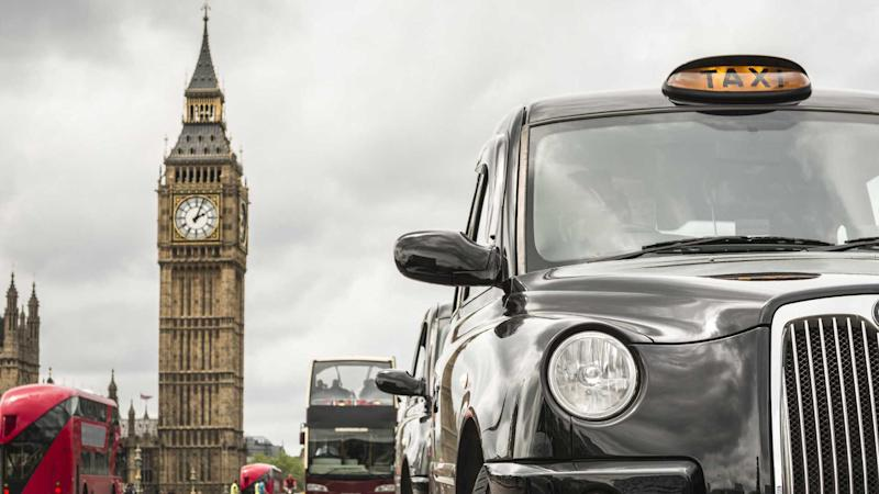 London taxi and red buse in front of big ben