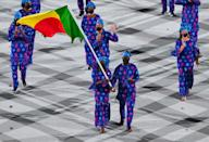 <p>Benin's flag bearer Nafissath Radji (L) and Benin's flag bearer Privel Hinkati lead the delegation during the opening ceremony of the Tokyo 2020 Olympic Games, at the Olympic Stadium, in Tokyo, on July 23, 2021. (Photo by Martin BUREAU / AFP) (Photo by MARTIN BUREAU/AFP via Getty Images)</p>