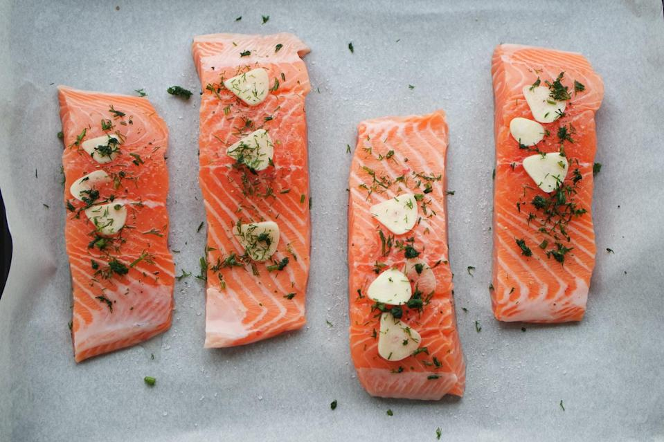 """<p>Fatty fish like salmon is rich in nutrients like vitamin D and healthy fats. Fish consumption has been shown to have a <a href=""""https://pubmed.ncbi.nlm.nih.gov/24812543/"""" class=""""link rapid-noclick-resp"""" rel=""""nofollow noopener"""" target=""""_blank"""" data-ylk=""""slk:positive impact on sleep quality"""">positive impact on sleep quality</a> among certain populations. This positive effect maybe partially be a result of the vitamin D content of the fish. </p> <p>Having your kids eat diets with a lot of variety and that includes fish and seafood may <a href=""""https://www.ncbi.nlm.nih.gov/pmc/articles/PMC6593378/"""" class=""""link rapid-noclick-resp"""" rel=""""nofollow noopener"""" target=""""_blank"""" data-ylk=""""slk:reduce the risk of poor sleep quality"""">reduce the risk of poor sleep quality</a>. From fish tacos to grilled shrimp, the seafood options are endless.</p>"""