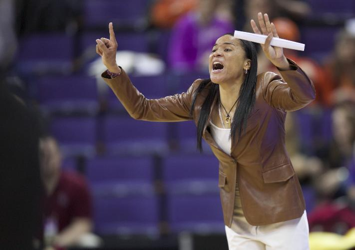 South Carolina head coach Dawn Staley yells to her team during the first half of a second-round game against Oregon State in the NCAA women's college basketball tournament Tuesday, March 25, 2014, in Seattle. South Carolina won the game 78-69. (AP Photo/Stephen Brashear)