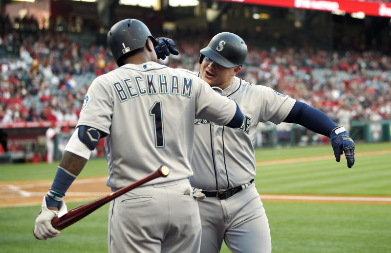 Seattle Mariners' Daniel Vogelbach, right, is congratulated by Tim Beckham after hitting a solo home run during the first inning of a baseball game against the Los Angeles Angels Saturday, April 20, 2019, in Anaheim, Calif. (AP Photo/Mark J. Terrill)