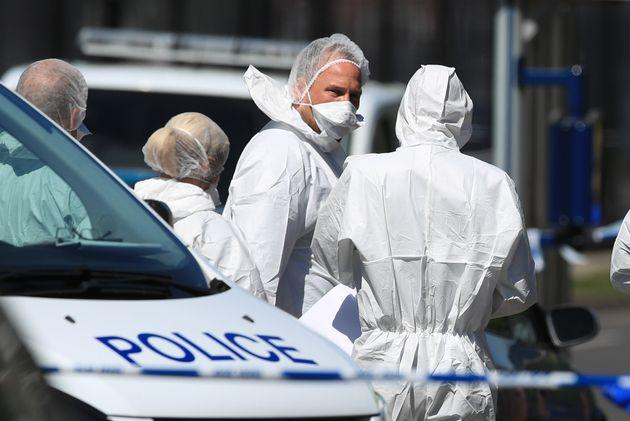 Forensics officers remain at the scene after six children were taken to hospital. Sadly two have died