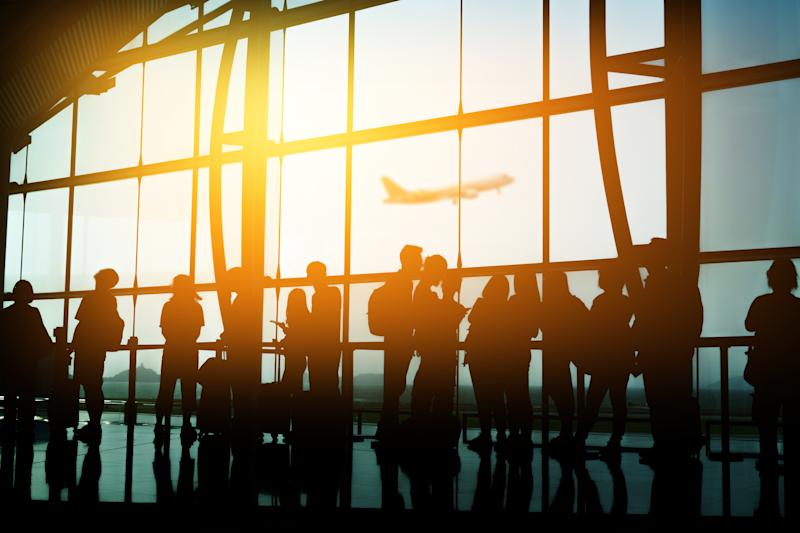 Passengers in an airport terminal.