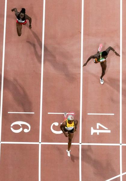 Shelly-Ann Fraser-Pryce, of Jamaica, wins her heat during the women's 100 meter semi finals at the World Athletics Championships in Doha, Qatar, Sunday, Sept. 29, 2019. (AP Photo/Morry Gash)